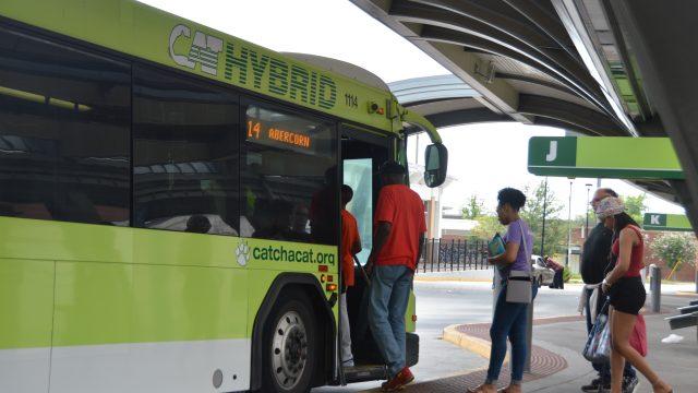 CAT riders boarding bus at transit center