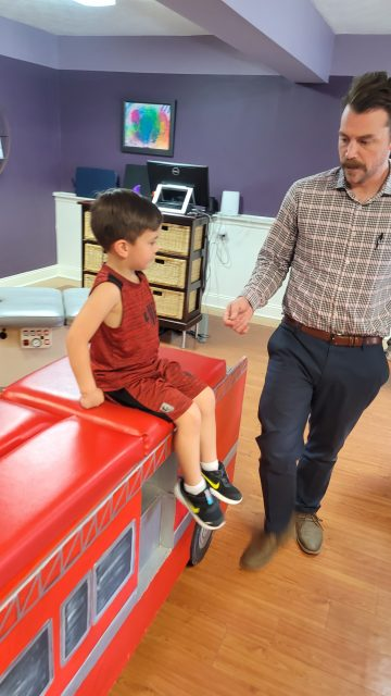 Dr. Elam checking in with a patient before an adjustment